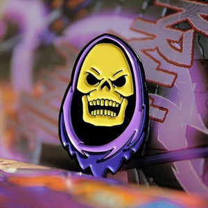 shot of the skeletor enamel pin on purple background