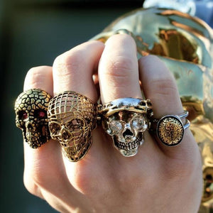 shot of a man wearing the Skull Of Zeus Ring and other skull rings from han cholo