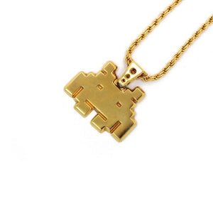 right angle view of the smiley invader pendant in gold on a white background