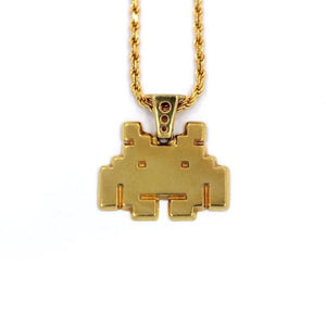 front view of the smiley invader pendant in gold on a white background