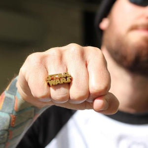 shot of a man wearing the Star Wars Logo Ring in gold from the star wars collection