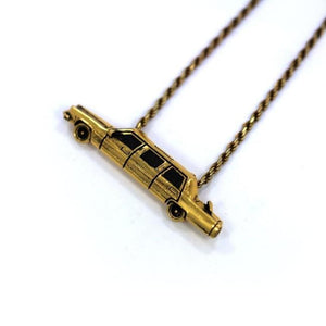 left angle of The High Life Pendant in gold form the han cholo cruising collection
