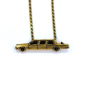 front of The High Life Pendant in gold form the han cholo cruising collection