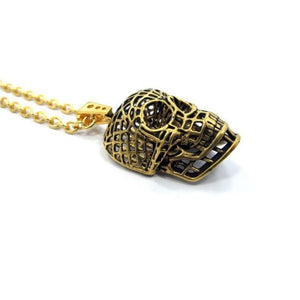 side of the Mesh Skull Pendant in gold from the han cholo skulls collection
