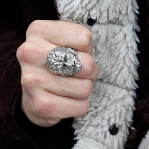 shot of a man wearing a black jacket with white fur wearing the wolfman ring