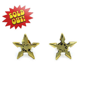 front of the Throwing Star 5 Point Earrings in gold from the han cholo shadow series