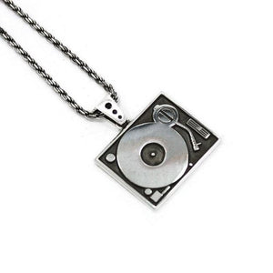 angle of the Turntable Pendant in silver from the han cholo music collection