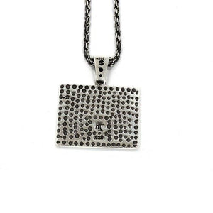 back of the Turntable Pendant in silver from the han cholo music collection