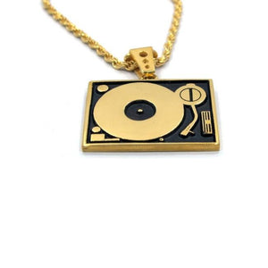 close up of the Turntable Pendant in gold from the han cholo music collection