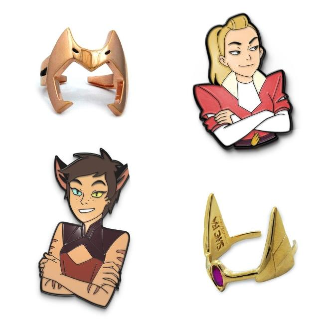 catra and adora enamel pins and she-ra rings from she-ra and the princesses of power