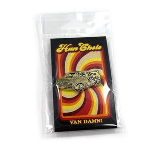 front of the Van Damn Enamel Pin in gold packaged from the han cholo cruising collection