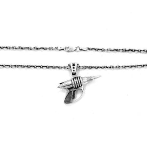 shot of the zap pendant in silver showing the clasp of the sterling cable chain on a white surface