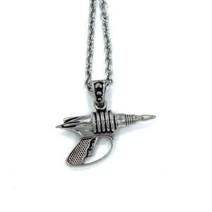 back view of the Zap pendant in silver on a white surface