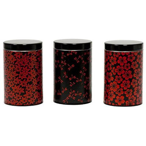 red and black tea canisters with different patterns