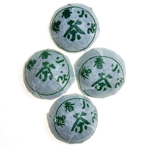 4 Sweet Rice Mini Sheng Pu-erh tea Tuo wrapped in white packaging with green characters