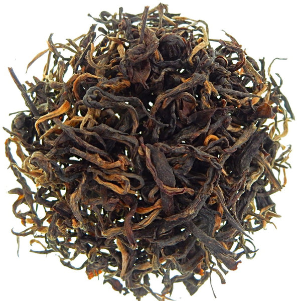 A wiry, long leafed black tea with gold tips