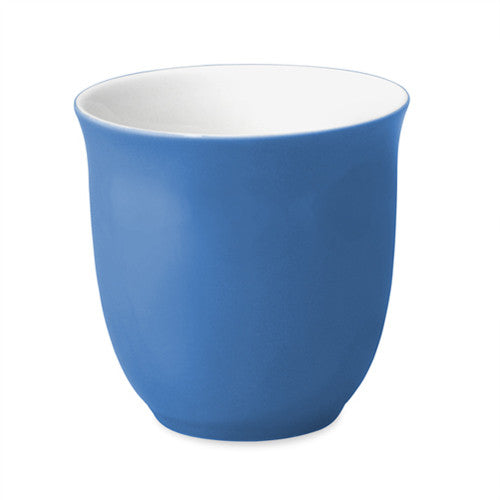 Tall and narrow Japanese style tasting cup with blue exterior and white interior