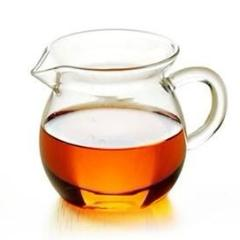 Glass tea pitcher with amber tea licqueur