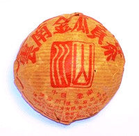 Golden Melon Chinese Shou Pu'er tea tuo wrapped in gold packaging with red writing