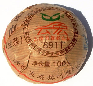 Green 8911 Chinese Sheng Pu-erh tea tuo in brown packaging