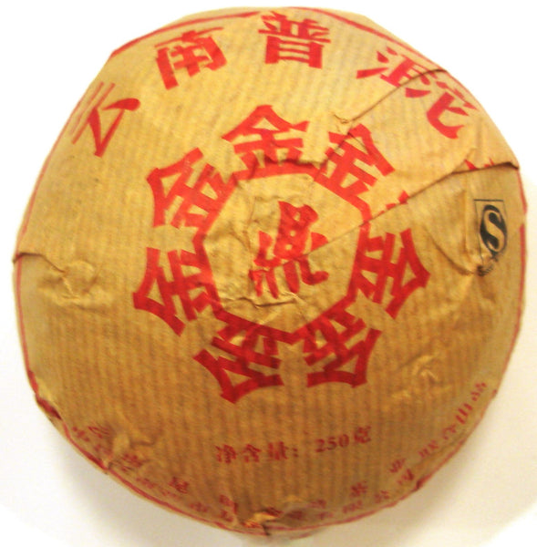 Jin Ding Chinese Shou Pu'er tea tuo in gold packaging with red characters