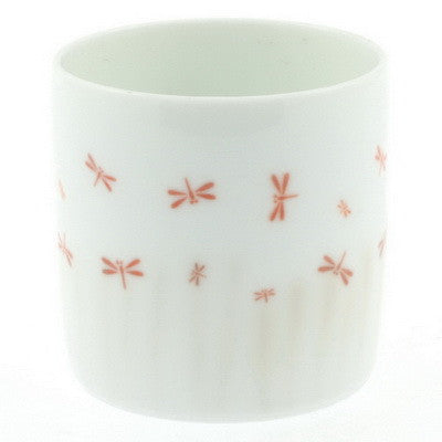 White tea cup with red dragonflies