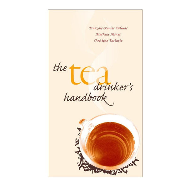 "Pale pink cover with a cup of tea and the title ""The Tea Drinker's Handbook"""