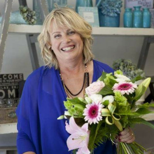gina christchurch florist holding flowers