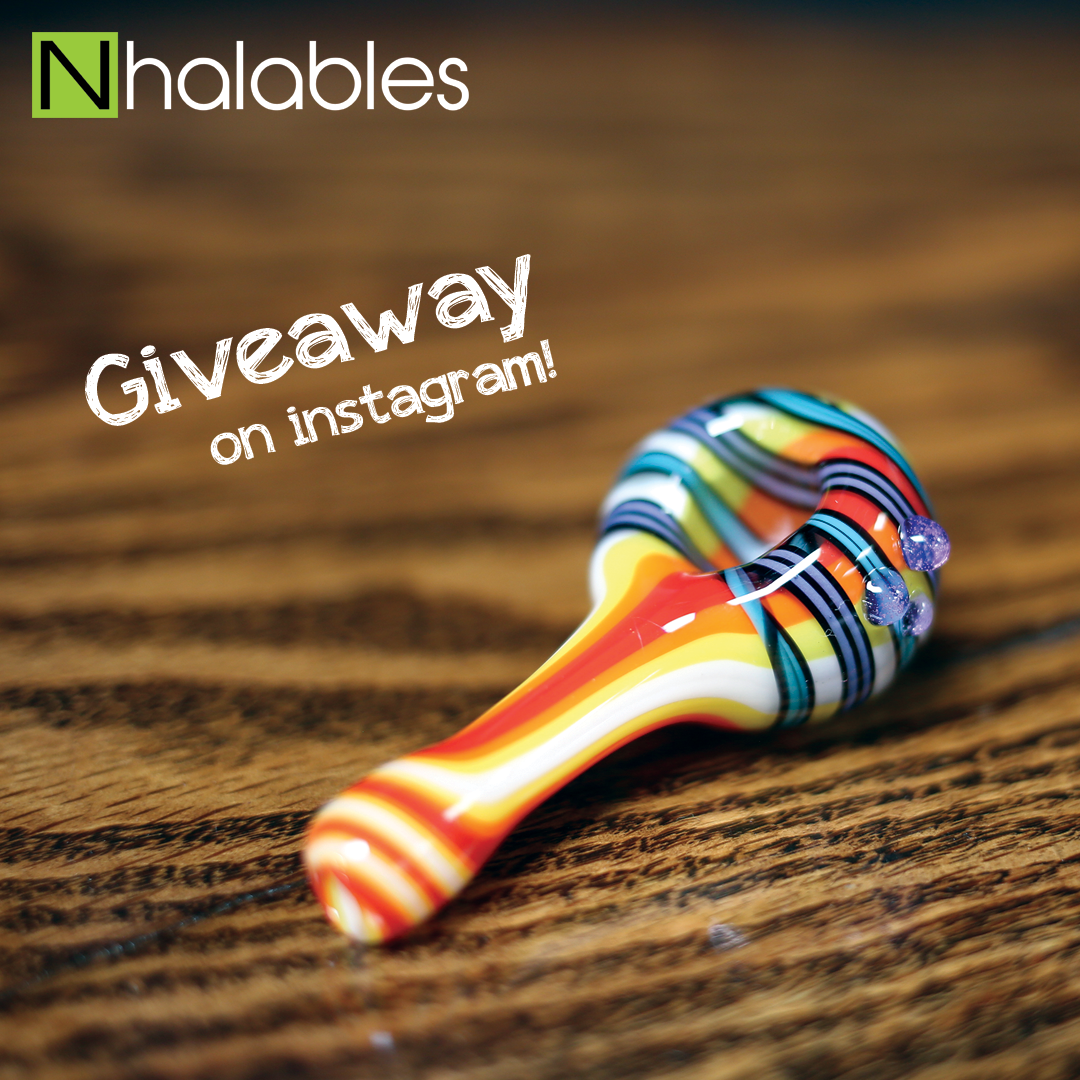 Nhalables Social Post showing a JEM Glass rainbow linework hand pipe sitting on a wooden shelf.