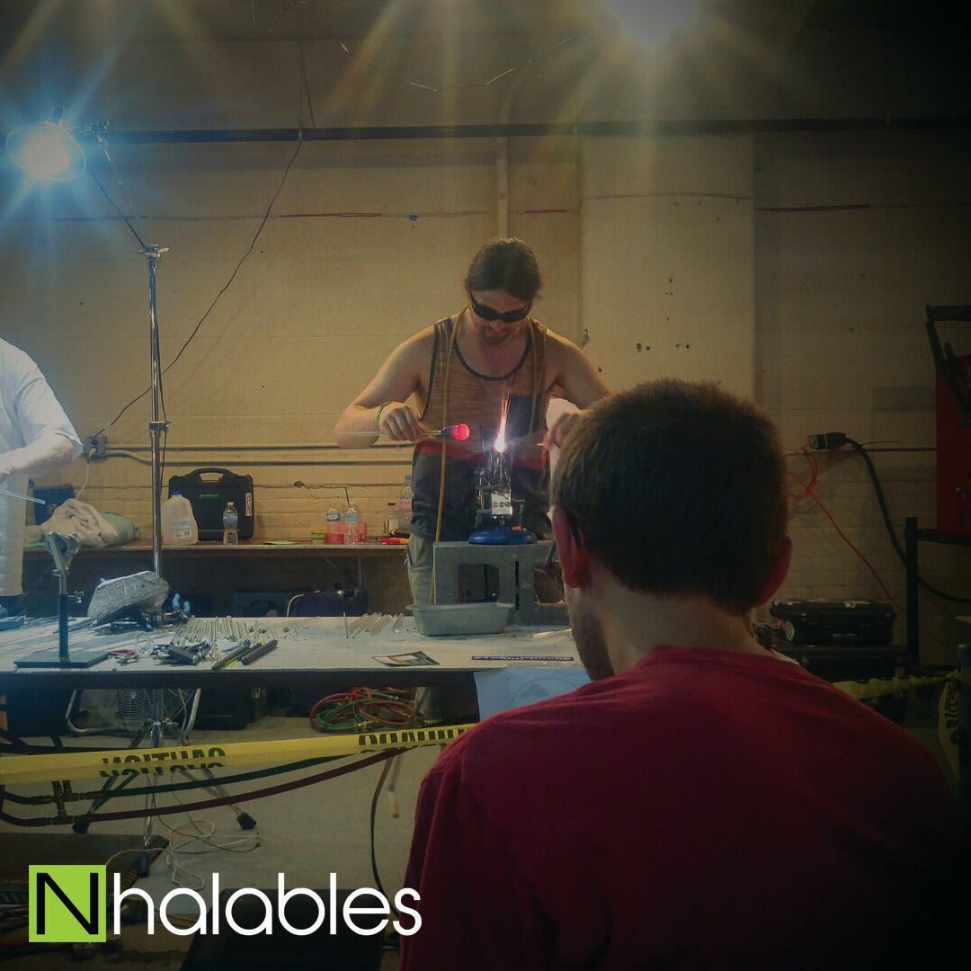 Nhalables Social Post showing Kinnickinnic Glass Doing his Glass Blowing Demo at Michigan Glass Project 2016 in Detroit Michigan.