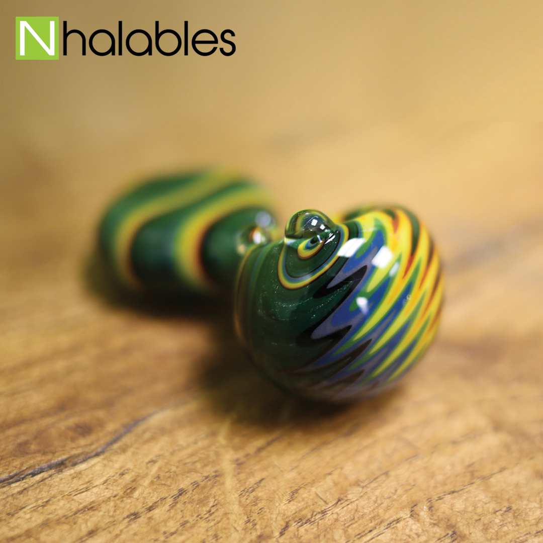 Nhalables Social Post showing the front side of a Alan Balades Handpipe sitting on a wooden shelf.