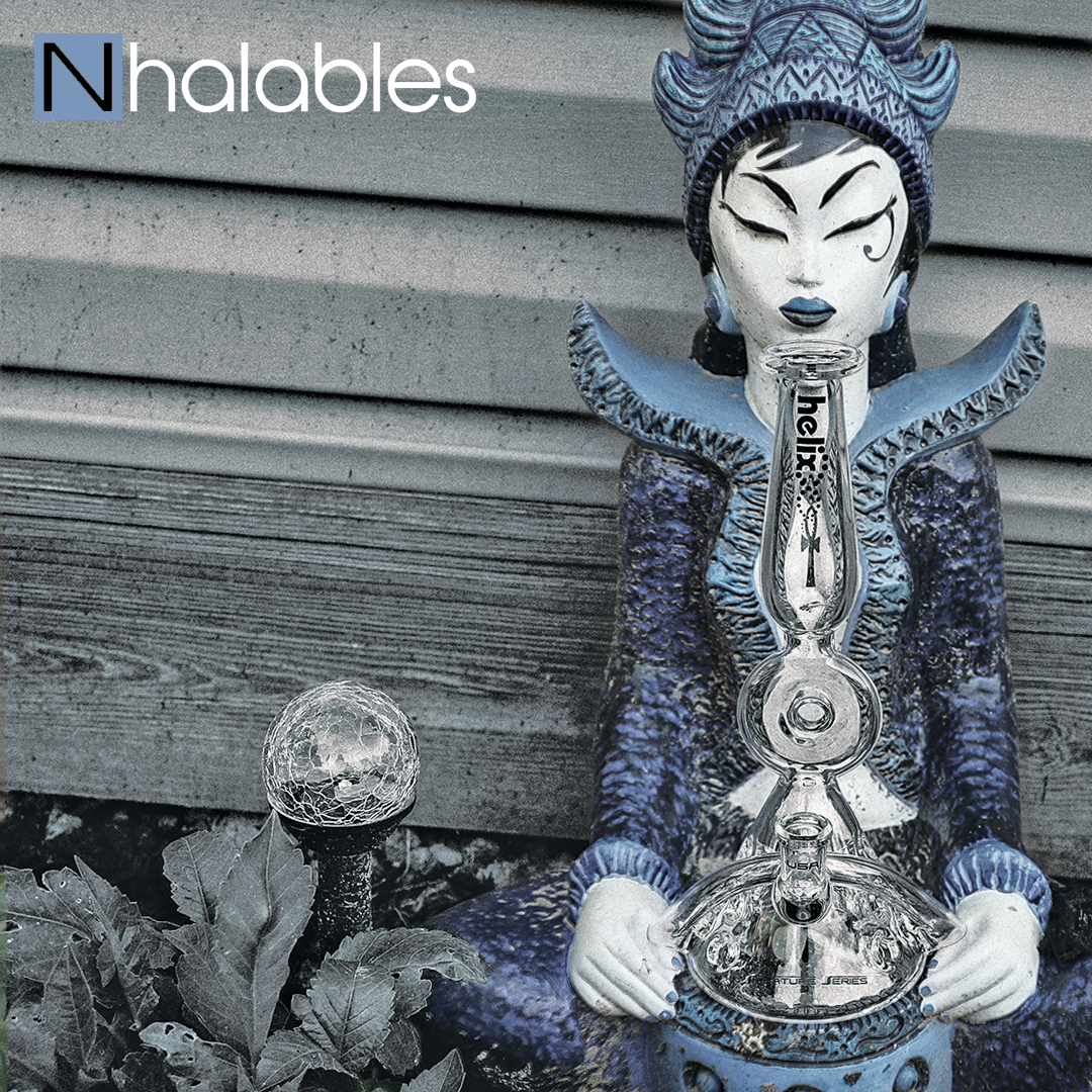 Nhalables Social Post Showing an American Helix + Charli Glass (texas) Kronos Waterpipe from their Titan Series Sitting in a lawn Sculpture