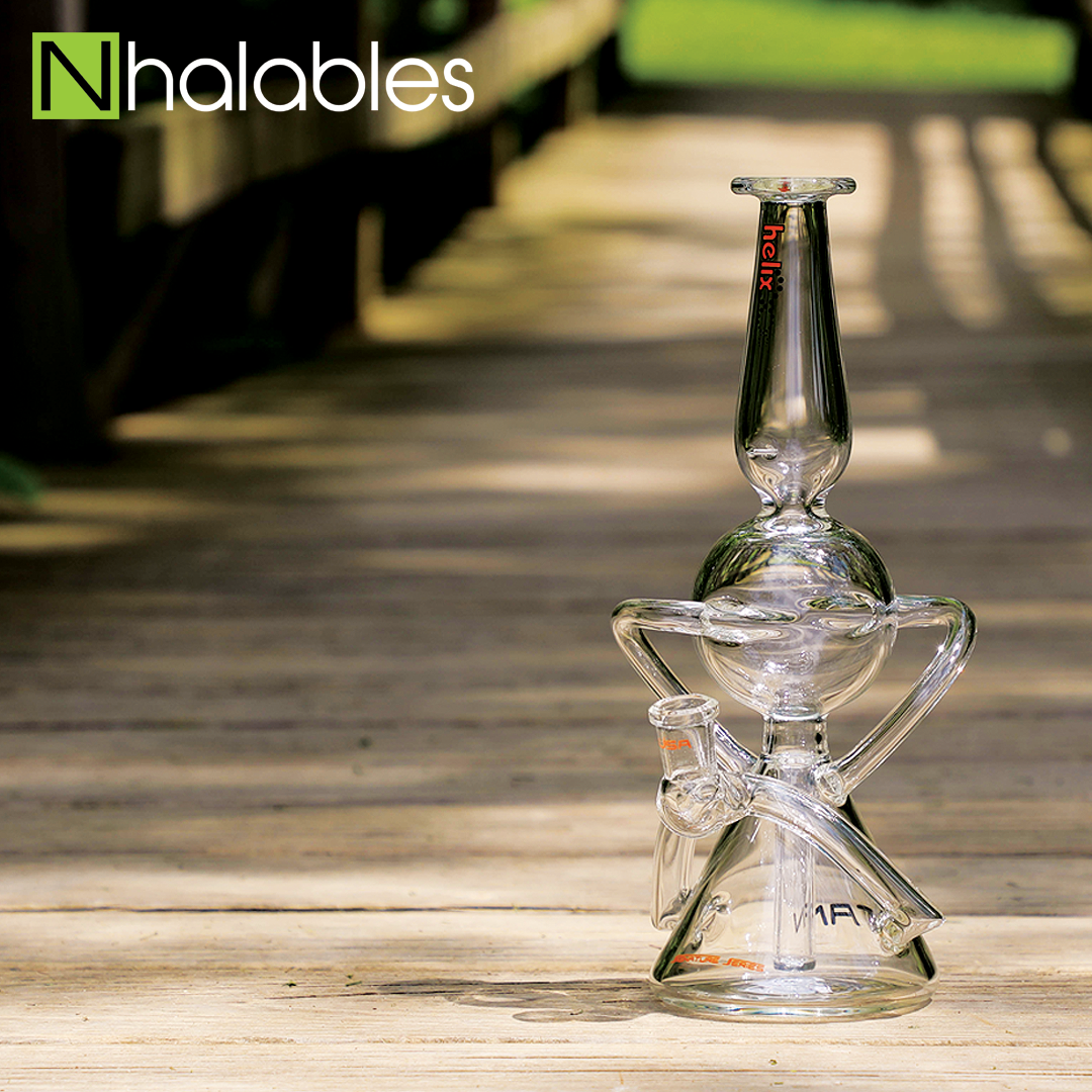 Nhalables Social Post showing an Texas Based Glass Company American Helix and Charli Glass ATLAS recycler oil rig sitting on a bridge in the sun.