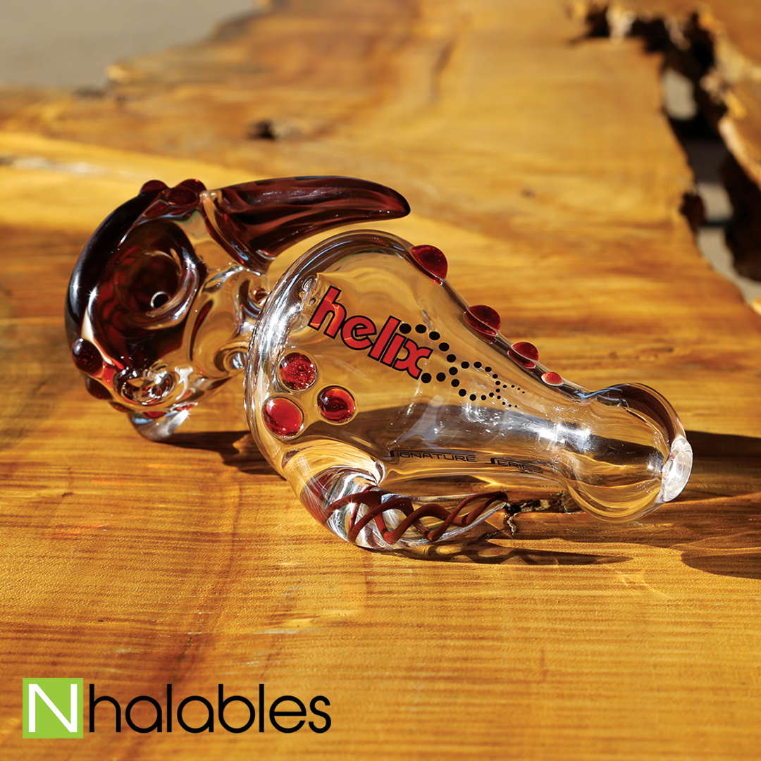 Nhalables Social Post Showing a American Helix Brand Red Horned Handpipe sitting on a wooden bench.