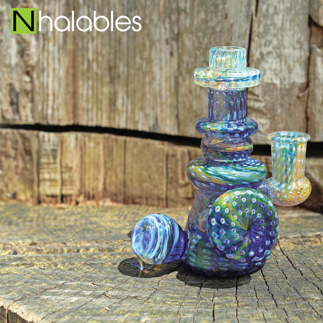 Nhalables Social Post showing a Fumed Bubbled Trap Glass Banger hanger Oil Rig By Cleveland Artist Durin K