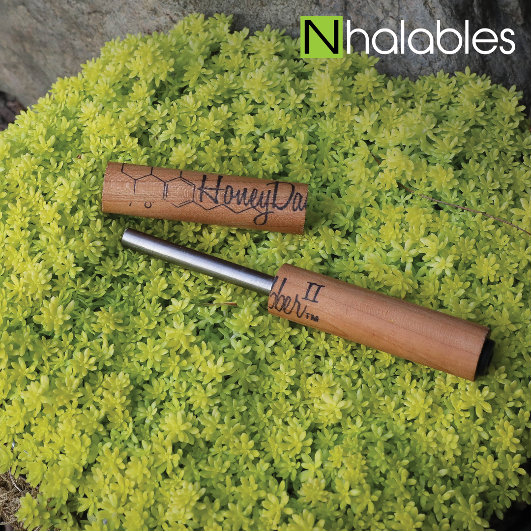 Nhalables Social Picture Showing The Honey Dabber 2 Concentrate Nectar Straw by Honey Labs LLC sitting in a green shrub.