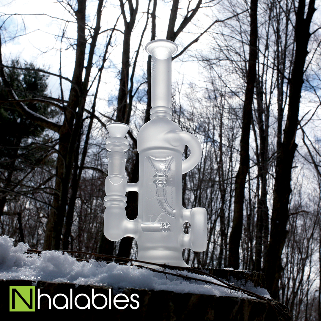 Nhalables Social Post showing a Seed of Life Glassworks Frosted Sol-Cycler Oil Rig Sitting in the snow with trees in the background