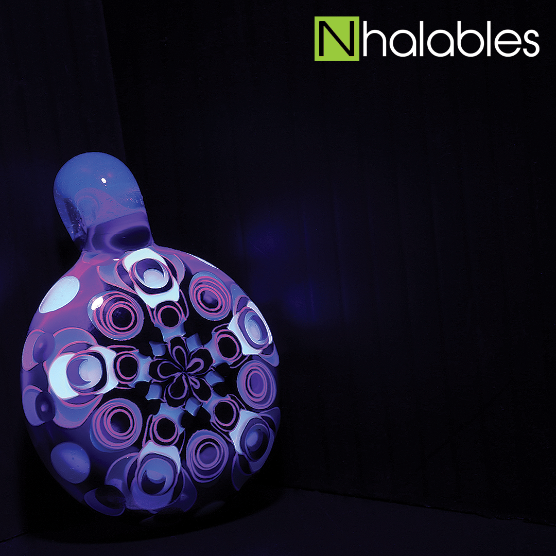 Nhalables Social Post showing a Ultra Violent (UV) shot of a JuJu Glass Blu-V Dotstack Pendant
