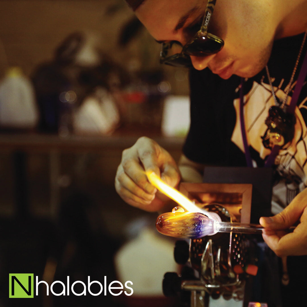 Nhalables Social Post Showing Glass Blower Firefly Glass doing his Glass Demo at Michigan Glass Project 2016 in Detroit Michigan.