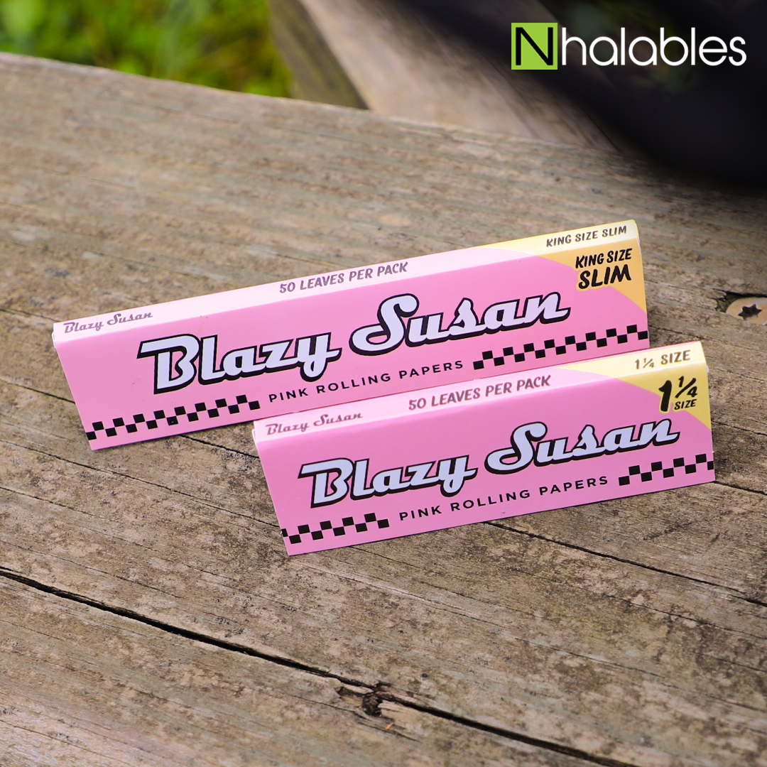 Nhalables Social image showing 2 packs of Blazy Susan rolling papers sitting on a wooden board