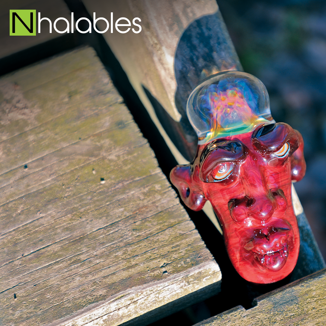 Nhalables Social Post showing a Mt. Catfish Glass Brainiac Handpipe sitting on a wooden Bridge