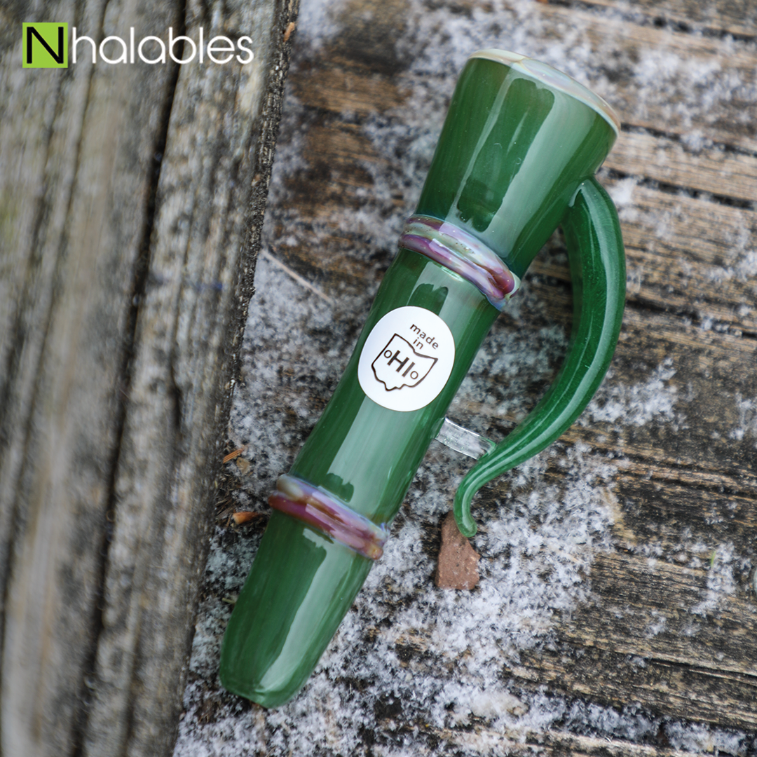 Nhalables Social Image for a Shamboo Chillum by Ohio based Glassblower Shamby Glass sitting on a piece of wood with snow around it