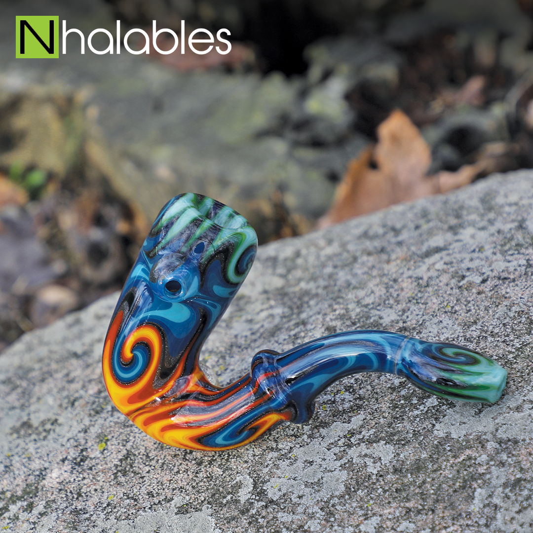 "Nhalables Social Post showing a Raindbow Linework Sherlock by Columbus, Ohio Based Artist ""Willstar Glass"" sitting on a rock with some fall leaves in the background."