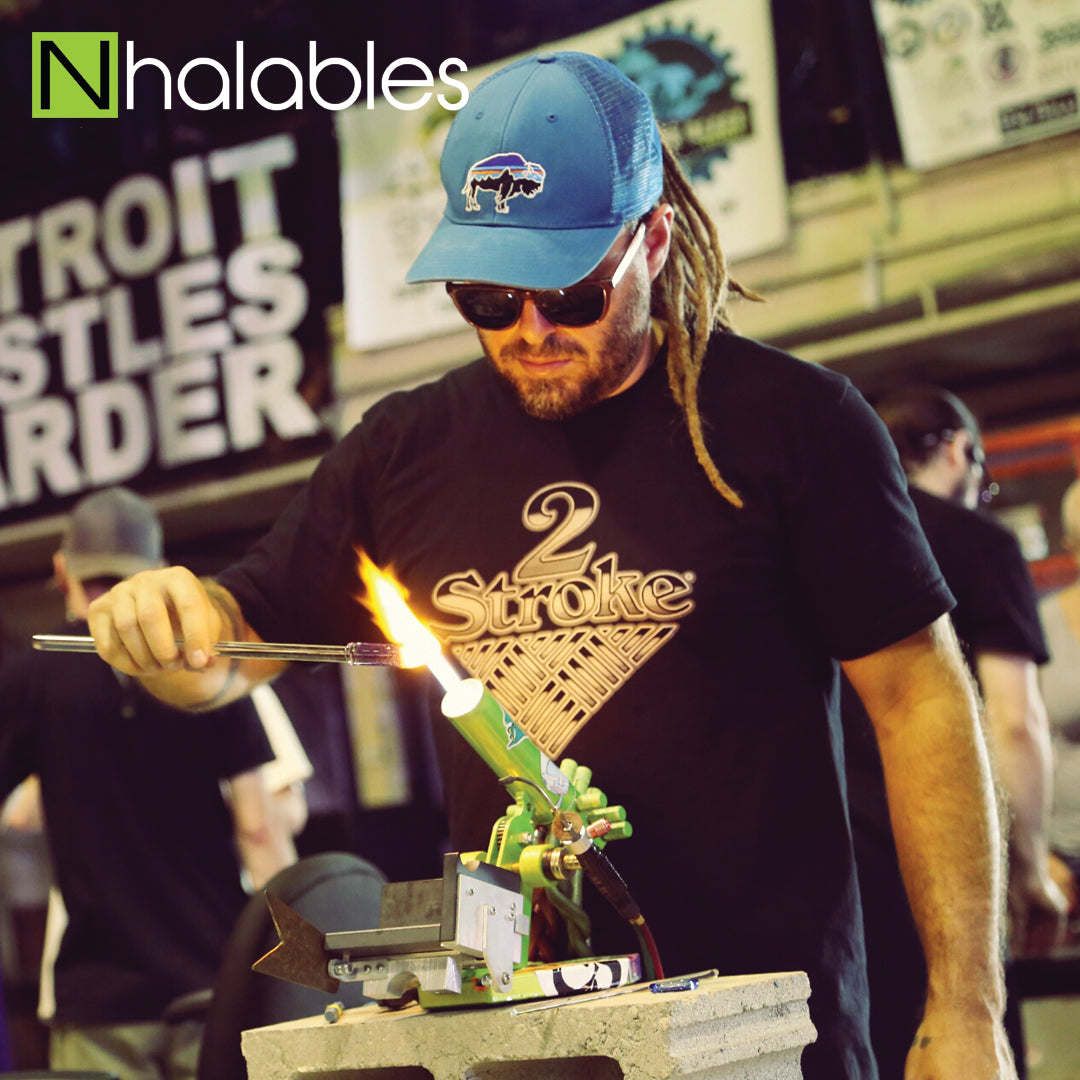 Nhalables Social Post Showing Glass Blower Brandon Martin Doing HIs Glass Demo at The Michigan Glass Project 2016 in Detroit Michigan
