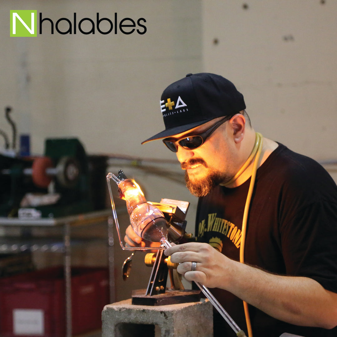 Nhalables Social Post Showing Glass Artist Tito Bern on the torch doing his glass blowing demo at Michigan Glass Project 2016 in Detroit Michigan