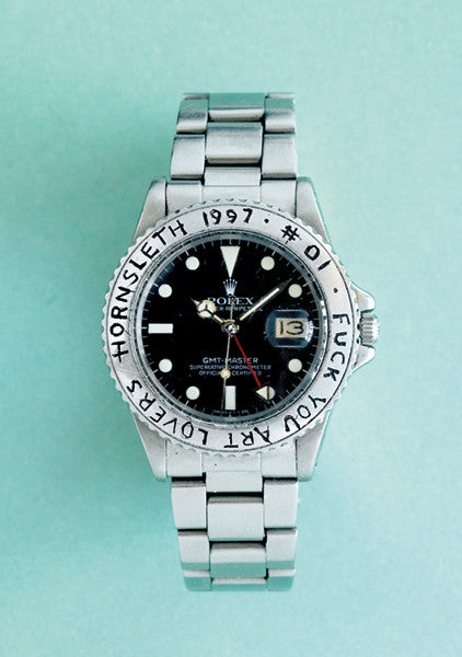 """ROLEX NO. 1"" Art Poster. A silver rolex watch with the worlds F*ck you art lovers engraved into the Rolex metal disc."