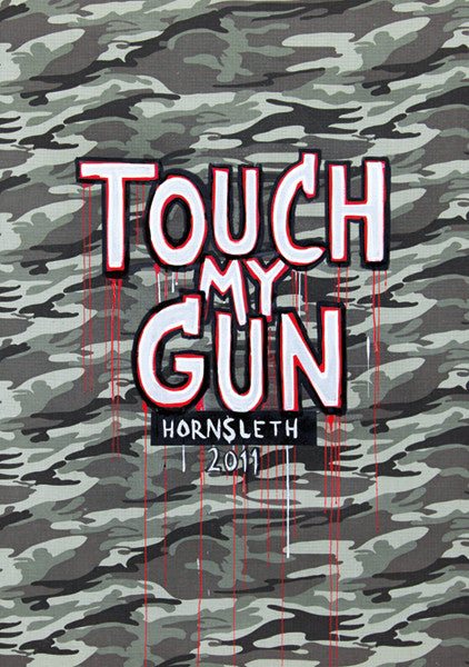 """TOUCH MY GUN"" Wall Art by Hornsleth. Affordable art poster, created from the original art piece. A provocative art piece by Danish artist Kristian von Hornsleth, with the words ""TOUCH MY GUN"" written in the middle."