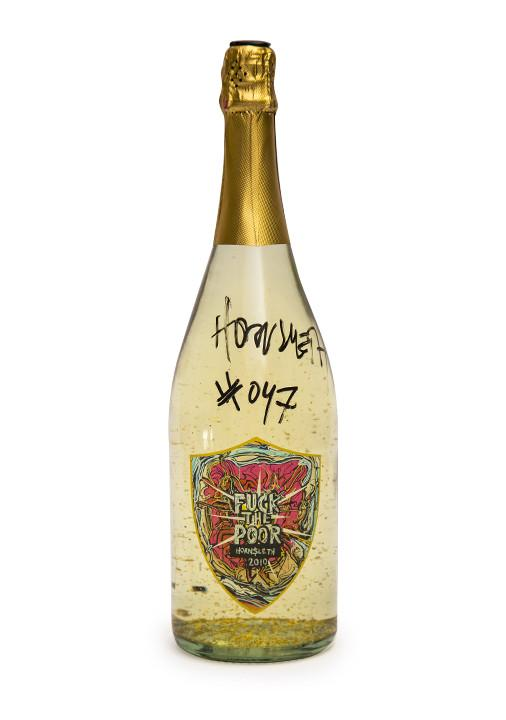 "CHAMPAGNE - Exclusive sparkling and delicious Champagne, contains real 24 carat gold leafs ""F*CK THE POOR LABEL"" - are designed to provoke unnecessary luxury and a decadent lifestyle, in shape of a symbol of wealth."
