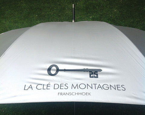 Le Cle des Montagnes branded umbrella