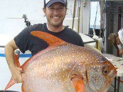 Marine biologist Nick Wegner with an opah, the first fish found to be warm blooded. (Photo: NOAA Fisheries, Southwest Fisheries Science Center)